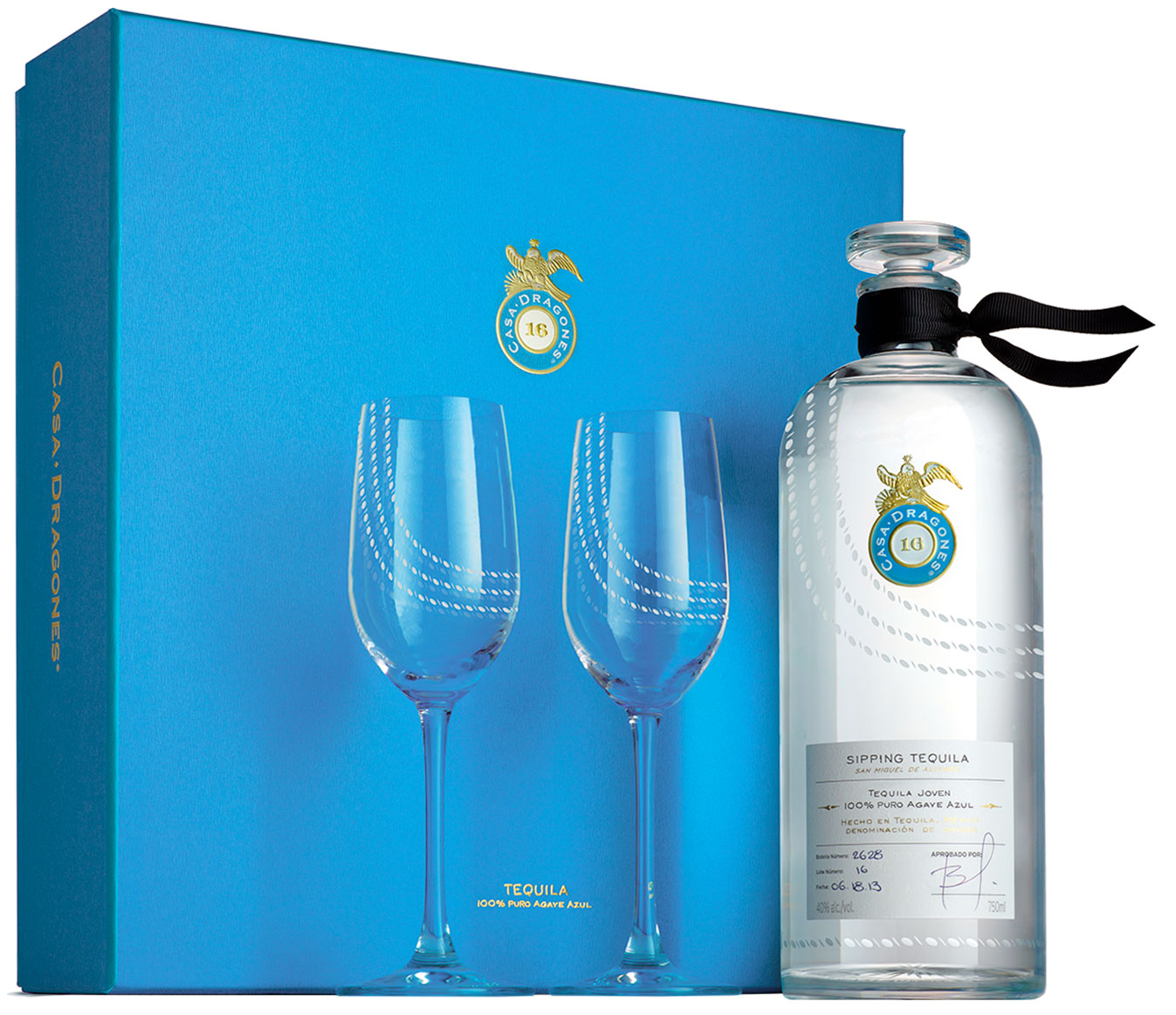 Bottle of Casa Dragones Sipping Tequila with two Reidel glasses, next to a blue holiday gift set box